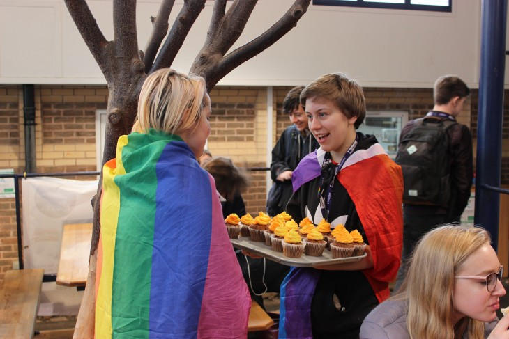 Students selling rainbow cup cakes in aid of Amnesty International's Chechnya Appeal