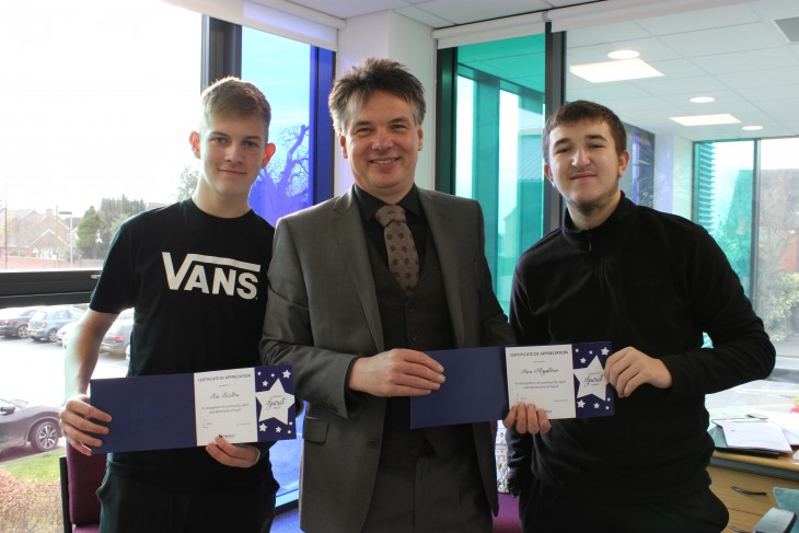 Pictured: Kai Burton (left) and Sam Mapstone (right) receive their awards from the Principal, Peter Cooper
