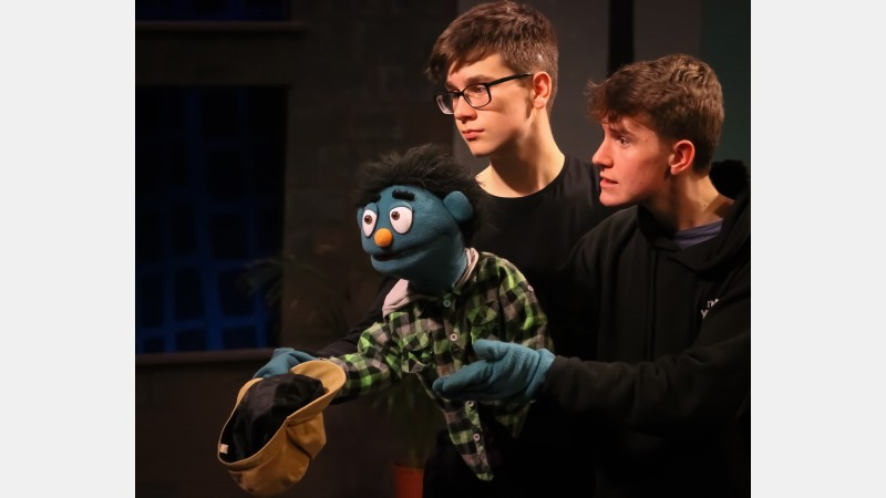 L-R: Zac Green as Nicky (supporting puppeteer) and Fletcher Garrard as Nicky (main puppeteer)