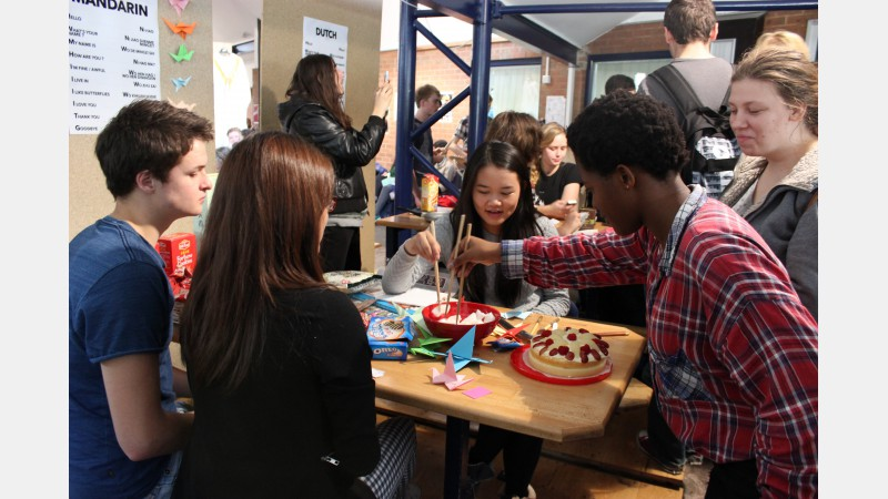 students practice using chop sticks and get a taste of flour-free Chinese cake on the Mandarin stand.