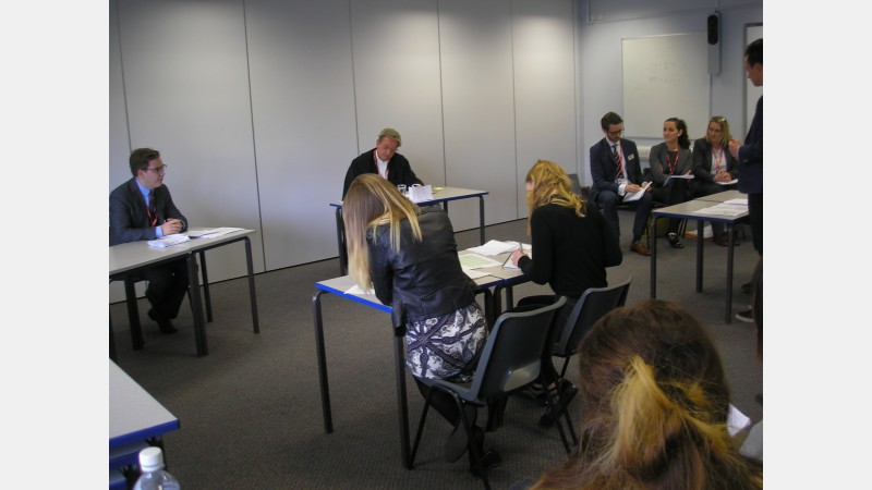 The students cross examine Paralegal, Christopher Finch, who played the defendant in the mock trial